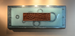 hand carved glass-large format carved glass-kiln worked glass-glass wall artwork-carved glass gears and chain-timing-wall mounted steel and glass-charles gabriel glassworks